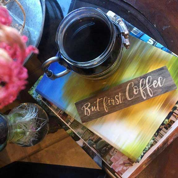 Coffee on top of books